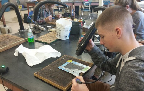 Stain glass students work on picture frames