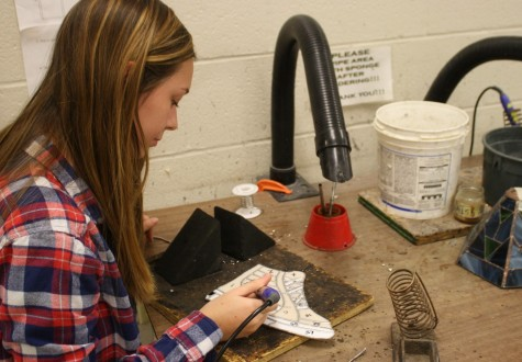 Senior Abby Combs works on her project today in stained glass.