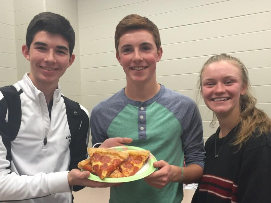 Sophomores+Gunnar+Hanson%2C+Robbie+Gonyea%2C+and+Brynne+Newland+celebrate+with+pizza+after+recieving+Panther+Plus+Awards