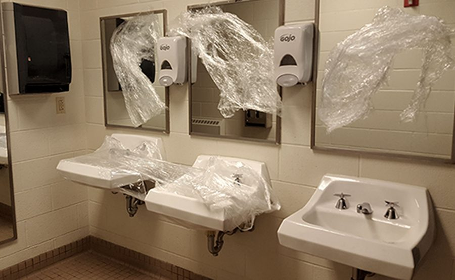 Bathrooms are vandalized with Saran Wrap
