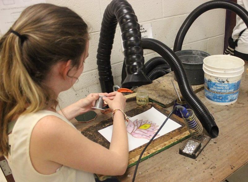 Sophomore Savannah Bruhn works on her