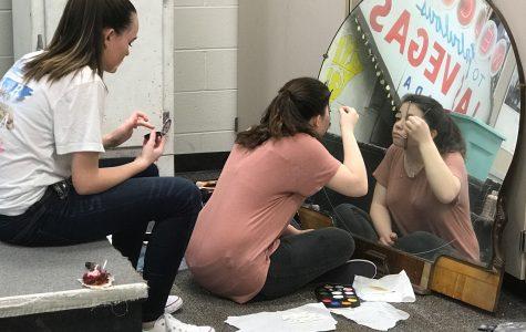 Theatre students practice stage makeup