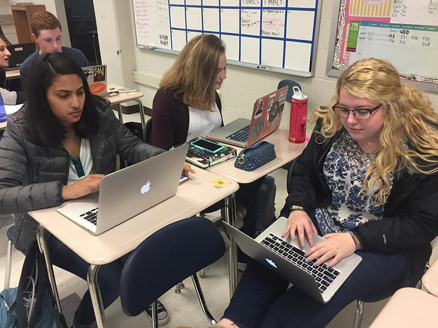 Yearbook members work hard to meet a deadline