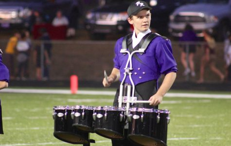Senior TJ Tankersley performs with Panther Regiment during last years half time show.