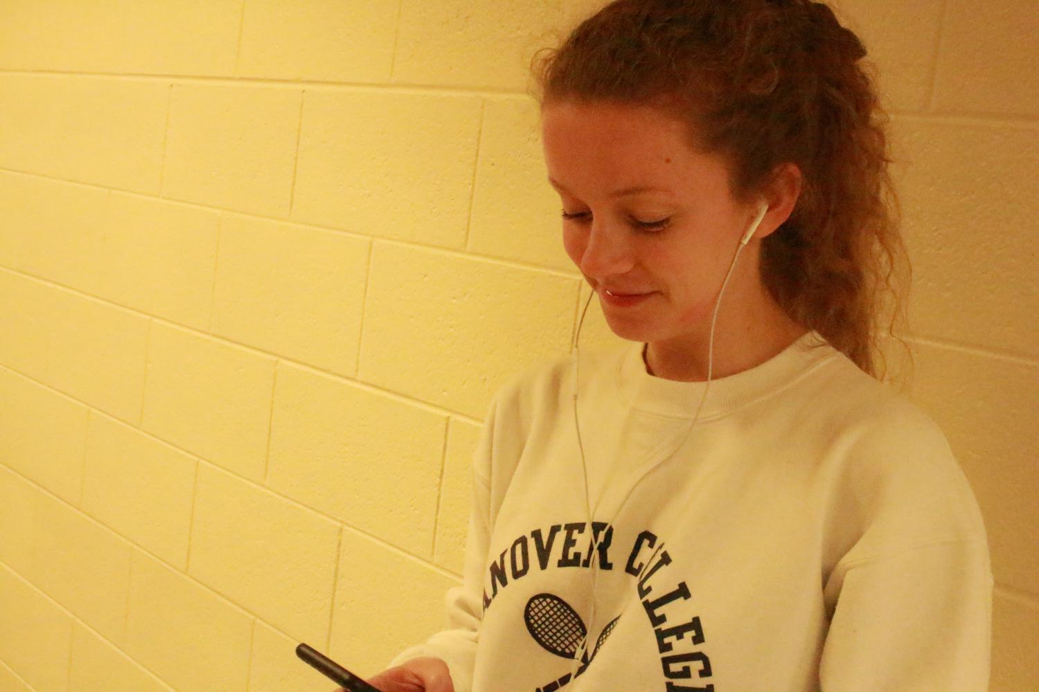 Senior Hadley Knaus listens to music in the South hallways