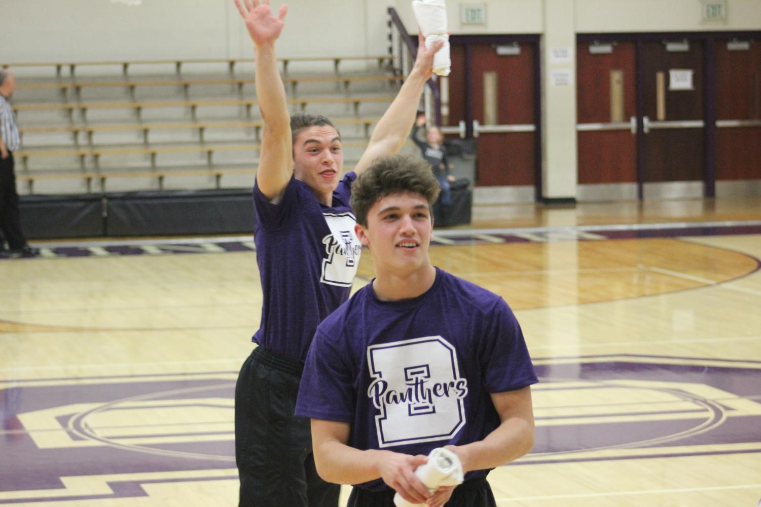 Sophomore Jedd Conrad (Front) and Senior Sam Conrad joined the cheerleading squad after deciding not to play football this year. The two brothers cheer at the varsity boys basketball games.