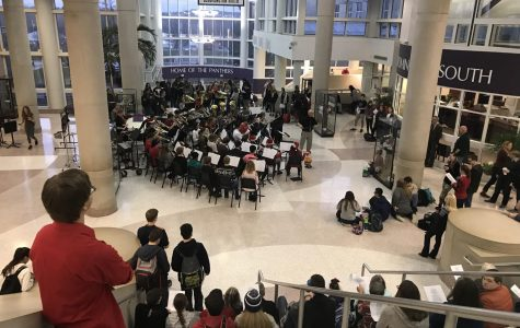 Band performs mini-Christmas concert in atrium