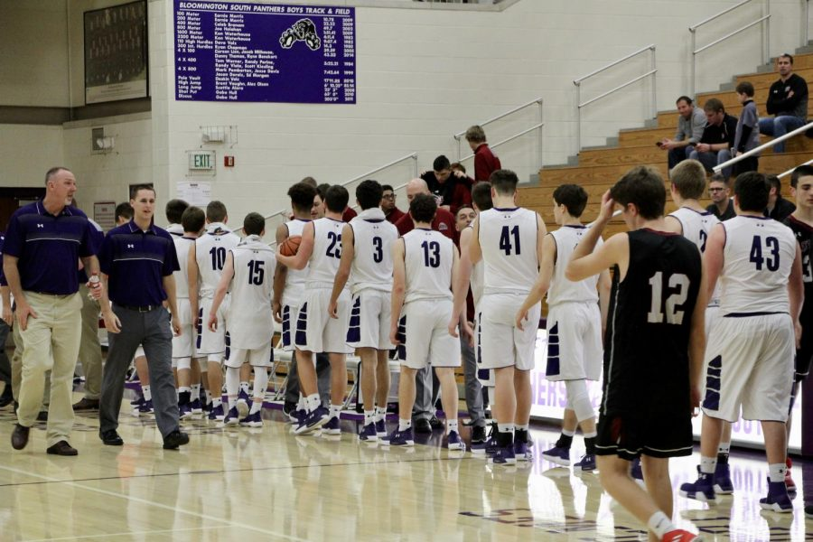 South shakes hands with the Lowell team.