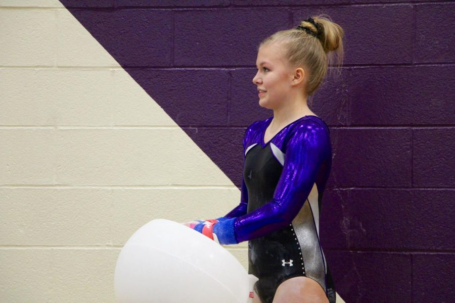 Souths Delaney Blubaugh chalks up her hands before she begins her beam routine.