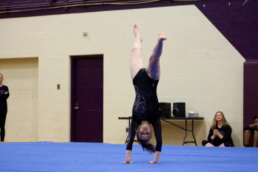 Norths Sarah Bickford preforms a back hand spring during her floor routine.