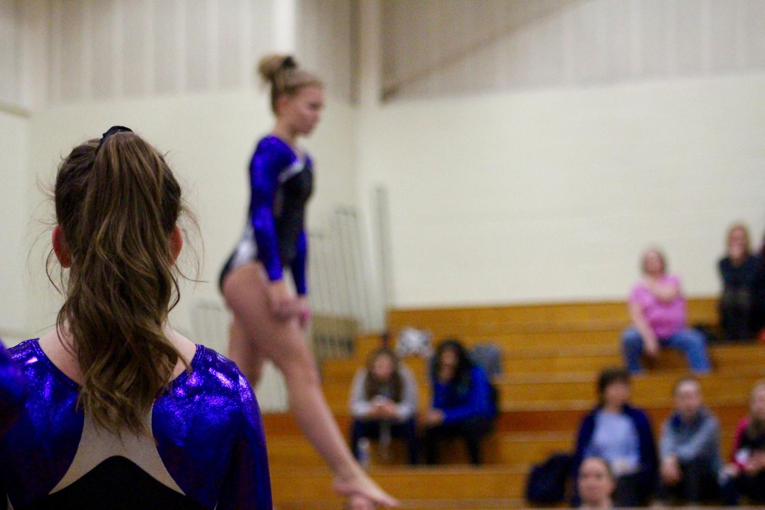 South's Carissa Moore watches as teammate Delaney Blubaugh preforms on the beam.