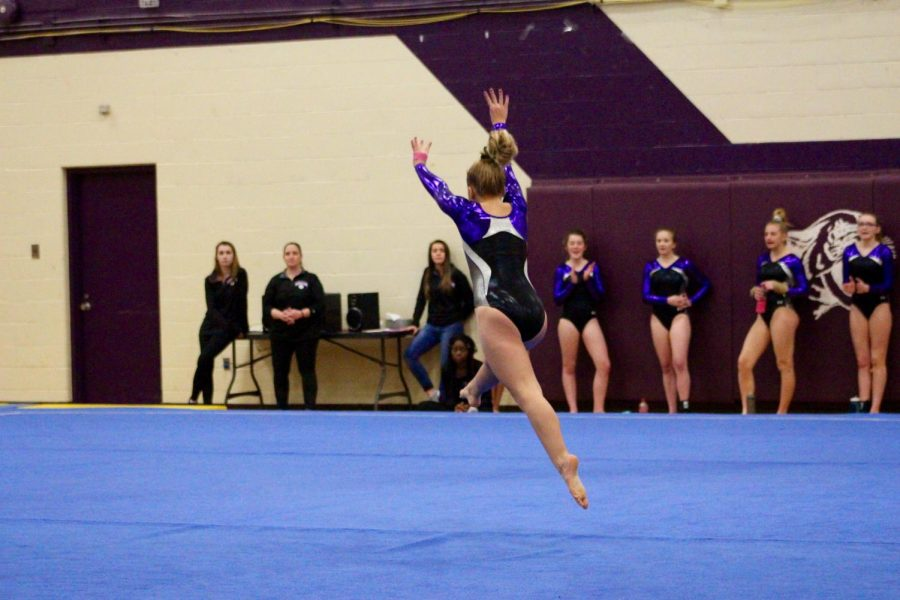 Souths Delaney Blubaugh prepares to do a stunt during her floor routine.