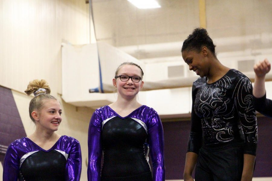 Souths Hailey Landis (left) and McKenzie Hales stand next to North winner Brittany Laffon on the poduim for the beam event.