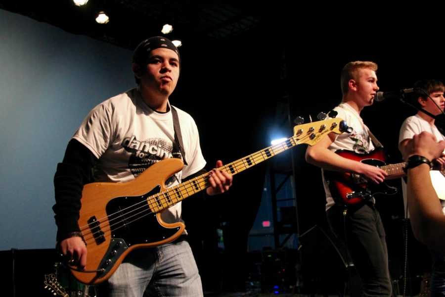 South senior and Elm Heights Band member Daniel Deckard rocks out while playing his bass guitar.