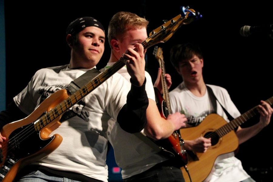 Elm Heights Band members Daniel Deckard and Hank Ruff go back to back while performing a song.