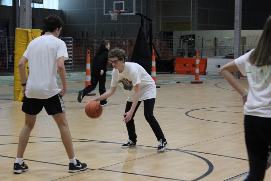 Junior Executives Scott Grabowski and Alan Morris play basketball.