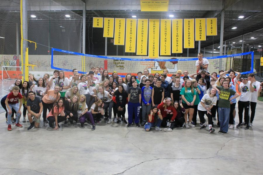 Middle school students pose with South and North executives after the middle school Red Hot hours end.