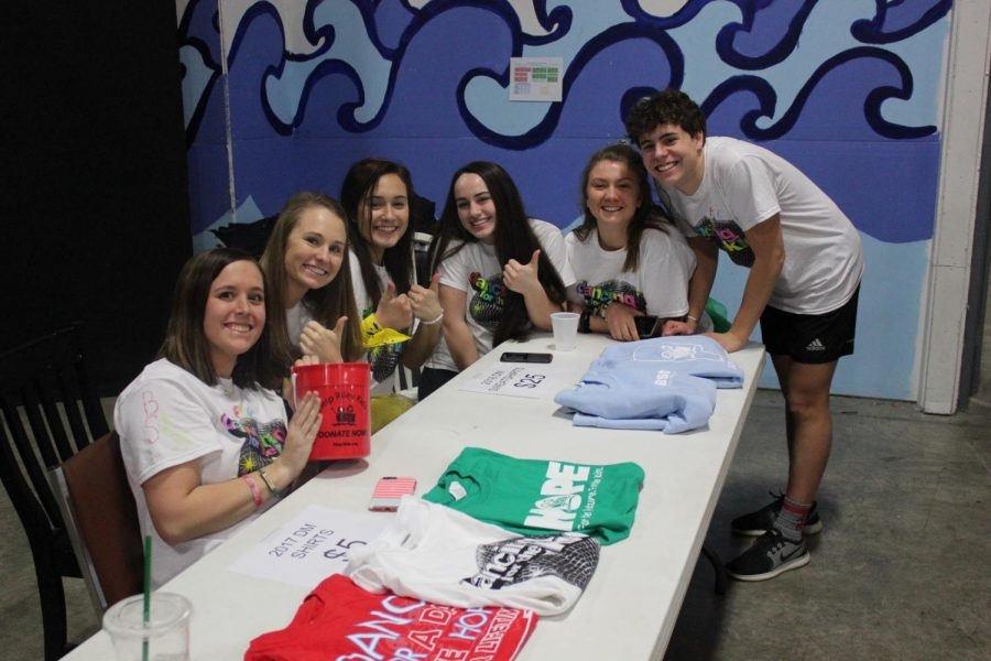 South junior executives pose at the merchandise table.