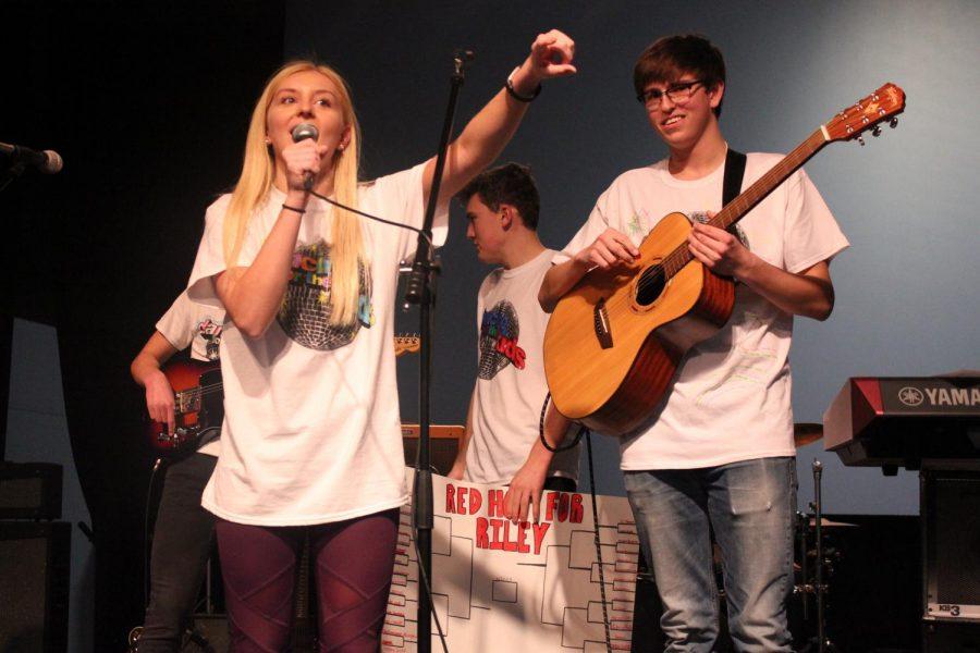 Senior Ashley Elliot announces the Elm Heights band.