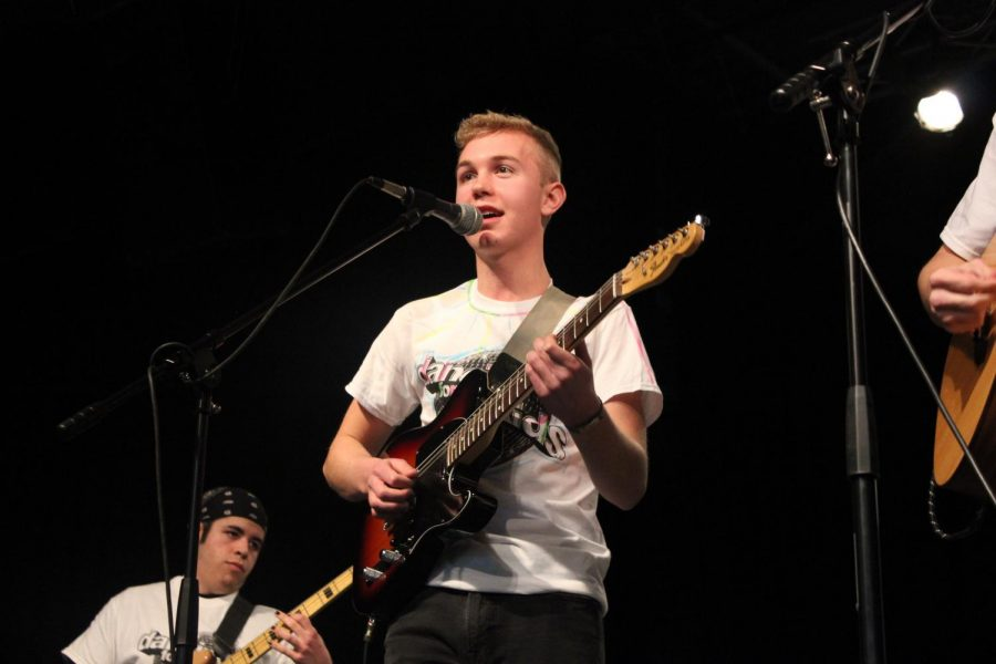 South graduate and Elm Heights Band frontman Hank Ruff sings and play guitar during Red Hot for Riley.