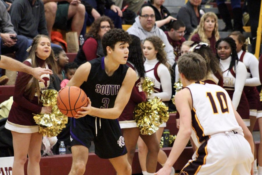 South's Anthony Leal (3) is guarded by North's Issac Vencel (10).