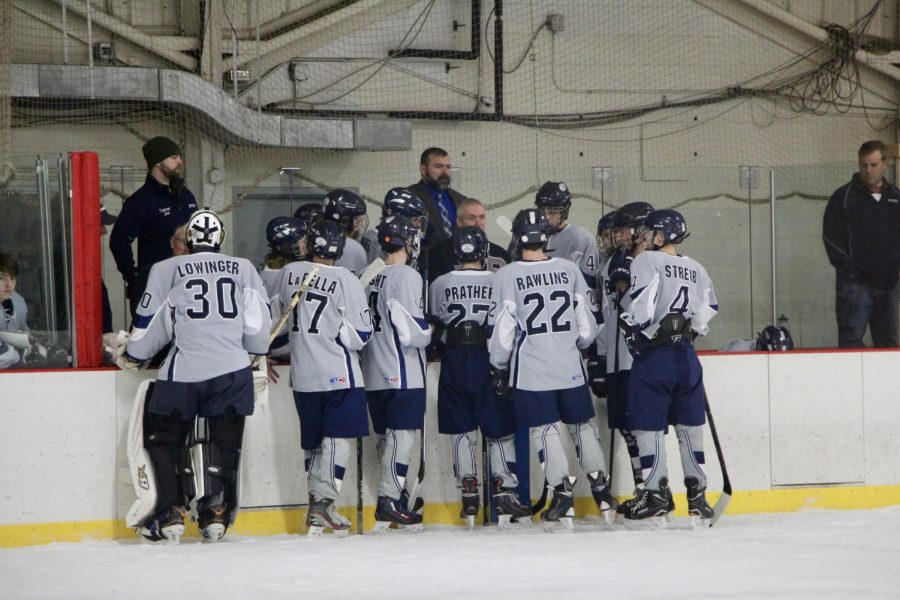 Bloomington Blades players huddle on the bench during a timeout.