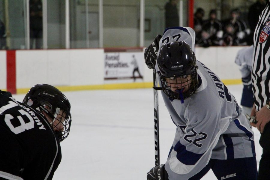 Bloomingtons Austin Rawlins (22) prepares for a face off against Centrals John McCarthy (13).
