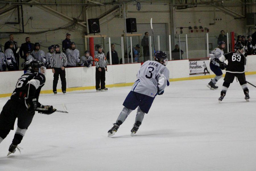 Bloomingtons Ethan Baer (3) skates towards the goal.