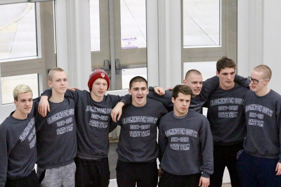 L-R: Seth Glasscock, Tommy Beggs, Max Grogg, Creighton King, Wesley Webb, Luke Lobring, Paul Gabhart, and Wyeth Michealsen pose together before leaving to compete in the boy's swim and dive state championships