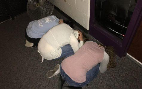 Students participate in tornado drill