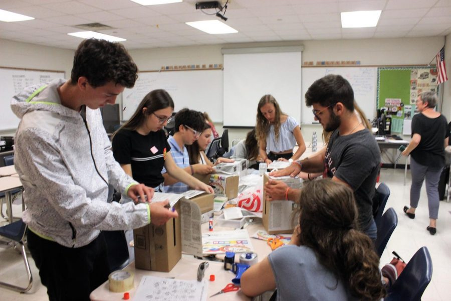International students help Optimist create comment boxes