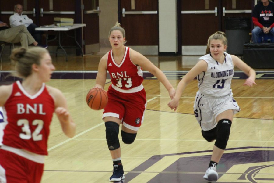 Junior Clara Voskuil (15) chases and guards BNL senior Jorie Allen (33)