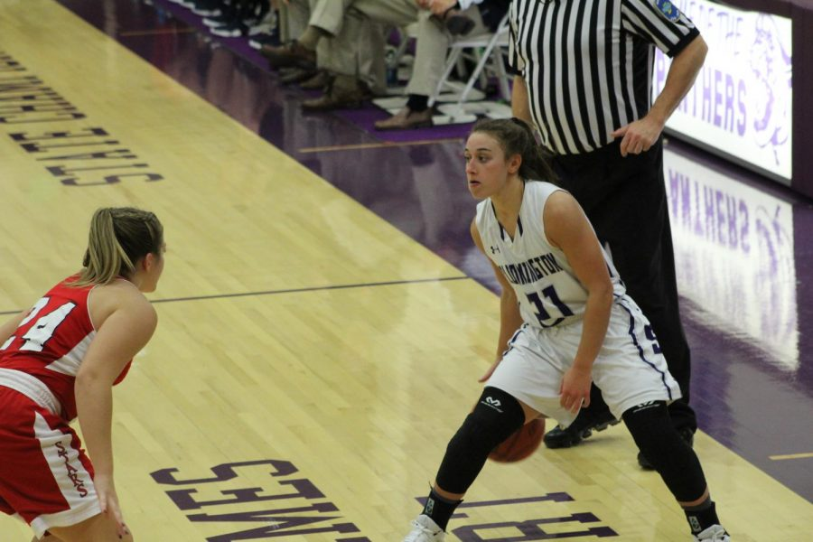 Senior Addy Blackwell (21) dribbles the ball as she prepares to make a play