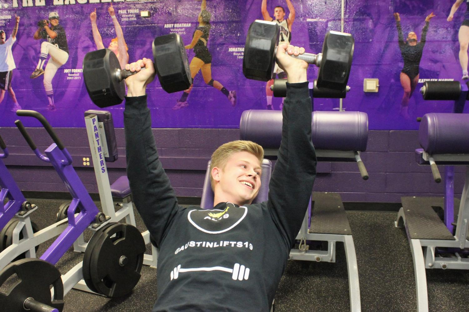Senior Austin Willis runs a bodybuilding account on Instagram. Willis is pictured above lifting in the South weight room.