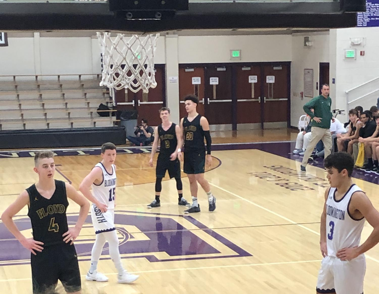 South's Noah Jager (15) and Anthony Leal (3) look on as Floyd Central's Jake Heidbreder (4) prepares to shoot a free throw