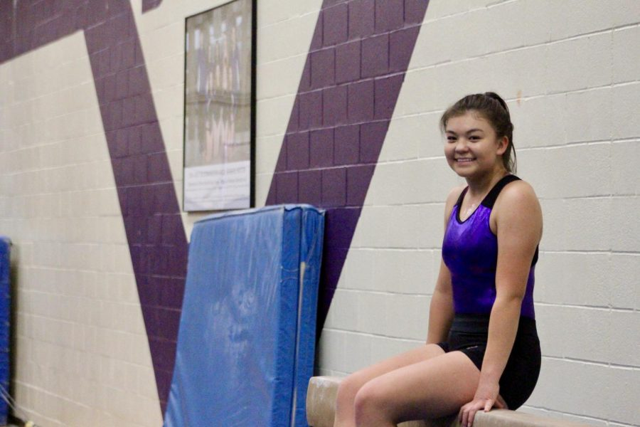 Senior+Lizbeth+Funkhouser%2C+who+joined+the+gymnastics+team+for+the+first+time+this+year%2C+poses+on+the+beam.