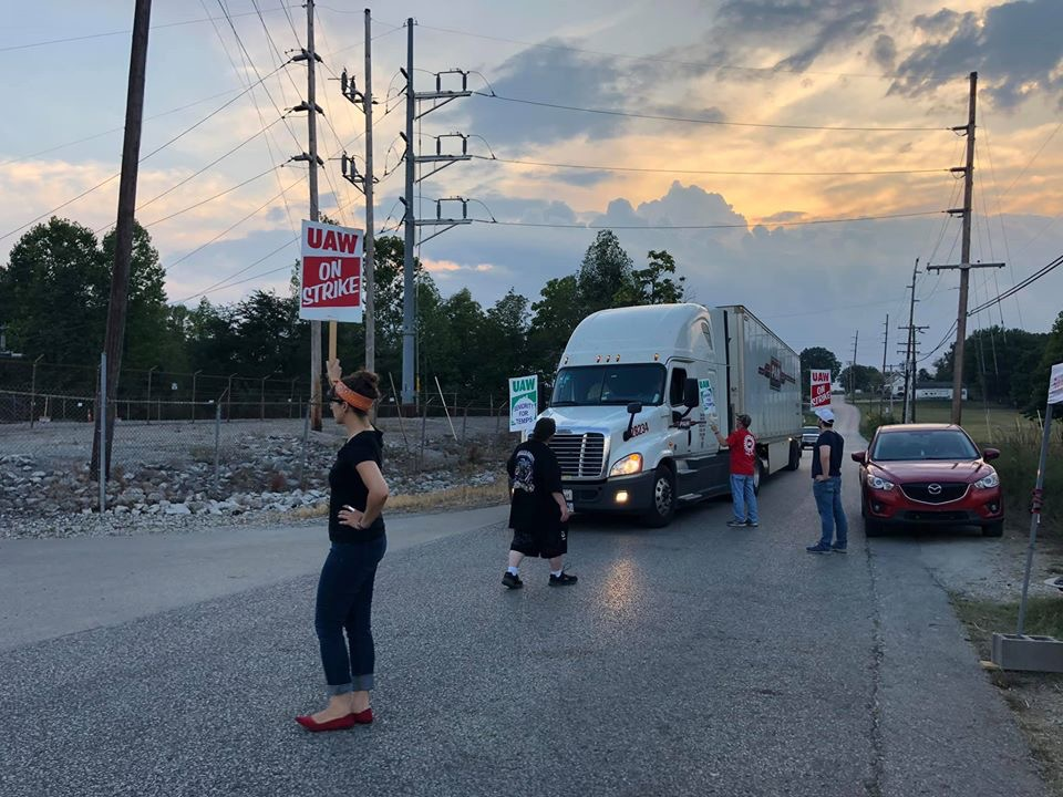 UAW strikers in Bedford, Ind. turn back a semi Friday evening