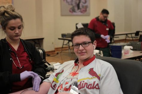 Bryce giving blood at the Red Cross blood drive this Thursday.