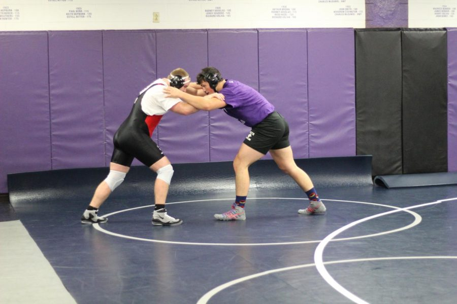 Tristan Ruhlman (right) wrestles at practice on December 3.