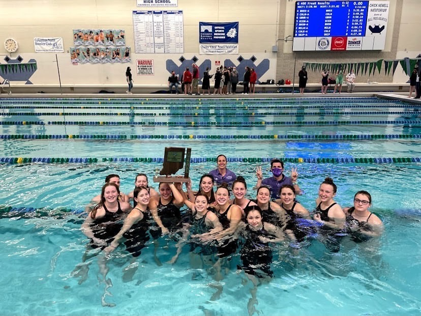 The swim team celebrates in the Columbus North pool after winning Sectionals on February 6, 2021. Photo credit: Allie Arnold.
