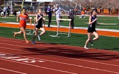 South freshmen Nora LoPilato and Clara Graham compete for the Panthers at the track meet April 3 against Columbus East. The girls team won 76-56, while the boys also triumphed 75-56.