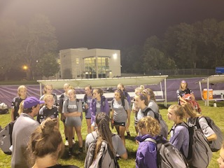 Head Coach David Prall talks to his soccer team prior to a game.